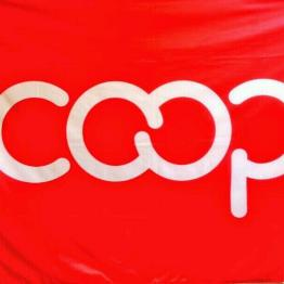 Coop logo with white letters on bright red background